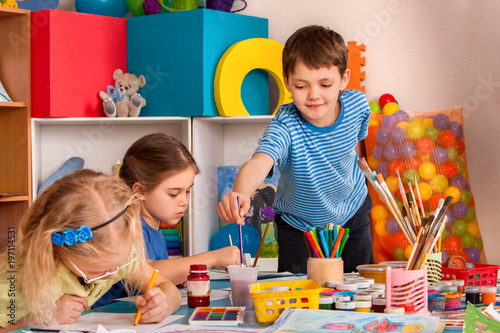 Small Students Painting In Art School Class Children Boy And Girl