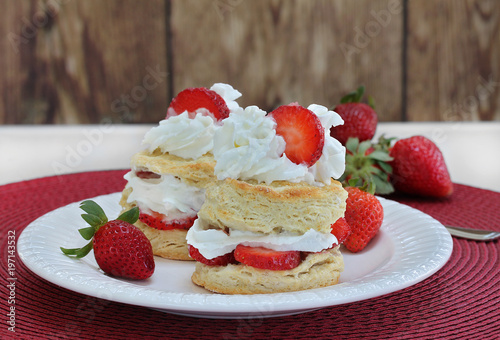 Canvas-taulu Two Strawberry Shortcakes with whipped cream on a white plate