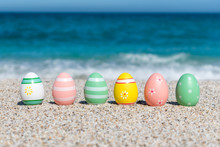 Colorful Easter Eggs On The Be...