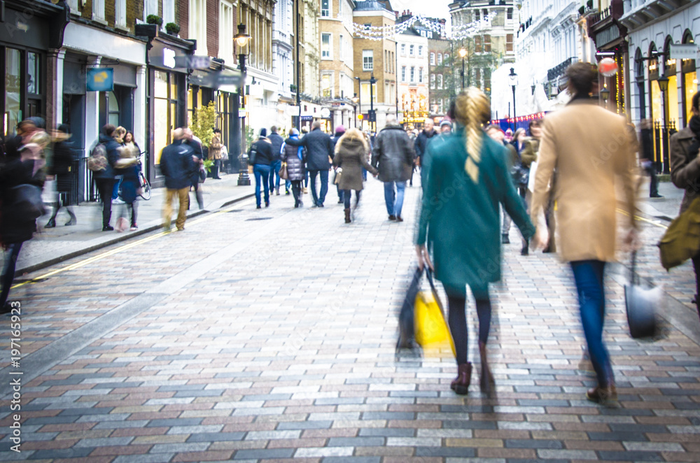 Fototapety, obrazy: Motion blurred couple on shopping street