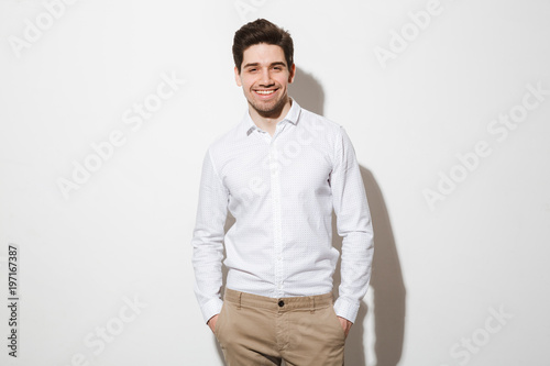 Portrait of a smiling young man dressed in shirt
