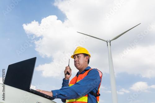 Architect or Engineer use Laptop computer and Transceiver handheld Radio Fototapeta