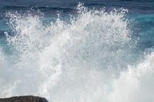 Waves Crashing Against Rocks