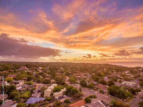 In de dag Centraal Europa Aerial view of glowing sunset over suburban area