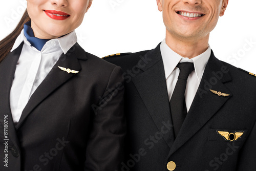 Close-up view of stewardess and pilot in uniform isolated on white Canvas Print