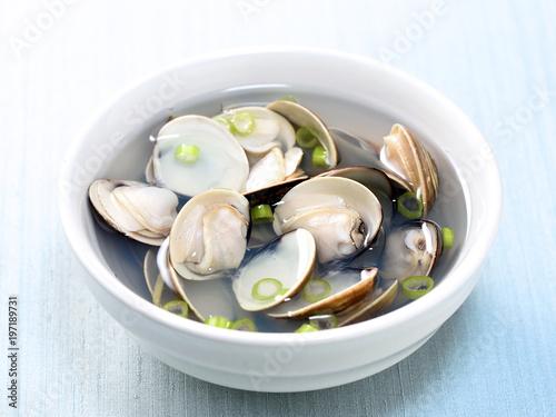 Fényképezés Clams soup cooked in a white pot in recipe