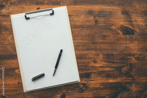 Fotografie, Obraz  Overhead view of blank clipboard note pad paper with pen