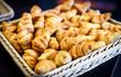 Fresh Croissants in a basket in buffet line.