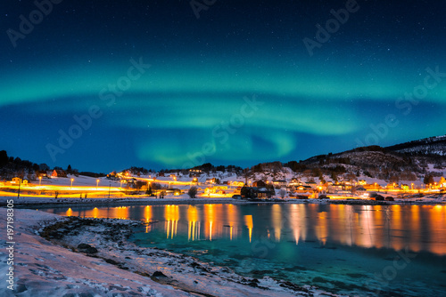 Papiers peints Aurore polaire Northern lights, Aurora borealis in night sky over Gausvik, Lofoten Islands, Norway. Scenic winter landscape