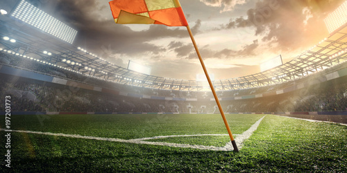 Sport. Empty football soccer field with white marks, green grass texture and orange corner flag.