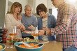 Group of senior friends preparing lunch meal together