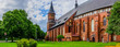 Leinwanddruck Bild - Panorama with a view of the famous Cathedral surrounded by lush summer greenery.