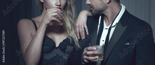 Fotografering Rich man with lover with drink in night club