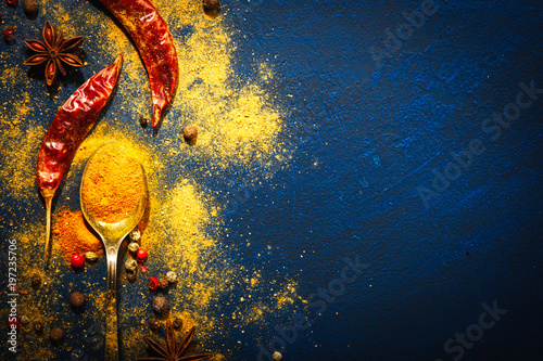 Poster Kruiden Wooden table of colorful spices