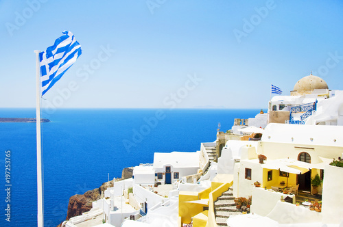 Staande foto Tunesië View of the village of Oia, Santorini, Greece. Traditional Greek architecture, white houses, the Aegean Sea, the caldera. White architecture against the blue sea