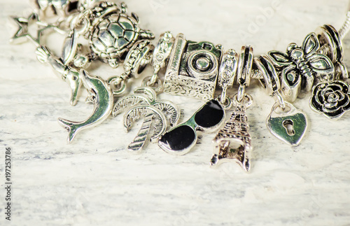 Photo bracelet with charms. selective focus.