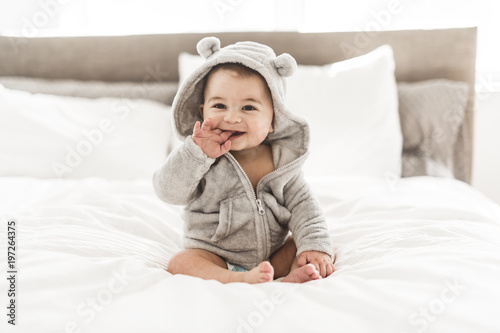 Obraz Portrait of a baby boy on the bed in bedroom - fototapety do salonu