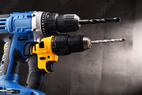 Two cordless drilsl with drill bits working also as screw guns