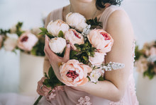 Woman Is Holding Flowers In Be...
