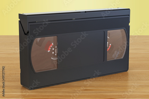 Valokuva  Videotape on the wooden table. 3D rendering