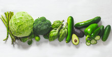 Green Vegetables  On A White Background. Flat Lay Series Of Assorted Green Vegetables. Fresh Organic Produce. Healthy Food. Top View