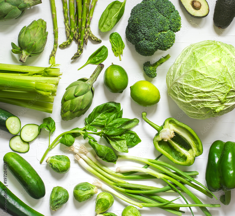 Green vegetables on a wooden background. Healthy food.