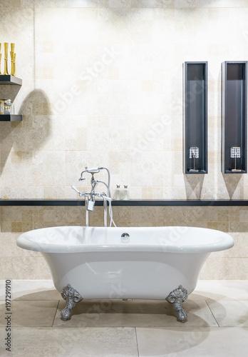 Fototapeta Bathroom interior in cozy colors with modern bathtub obraz na płótnie