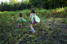 Girls Dressed As Fairies Hikin...
