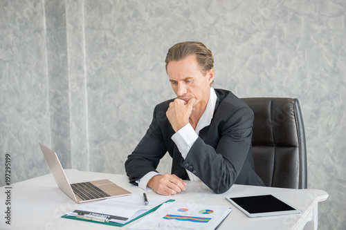 Garden Poster Serious businessman stressed out at work in office. fail business concept.