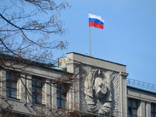 Russian Flag And The Soviet Coat Of Arms On The Parliament Building In Moscow