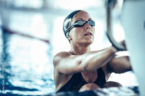 Obraz na płótnie Professional swimmer in training, indoor swimming pool