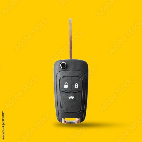 New key car on yellow background. Canvas-taulu