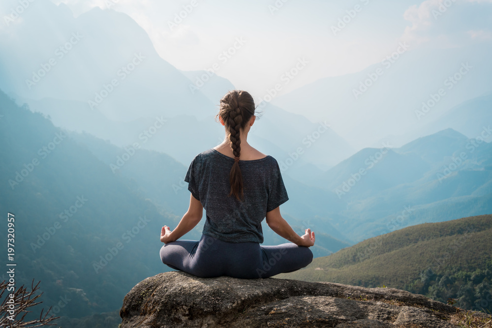 Fototapety, obrazy: Woman meditates in yoga asana Padmasana