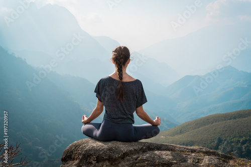 Woman meditates in yoga asana Padmasana
