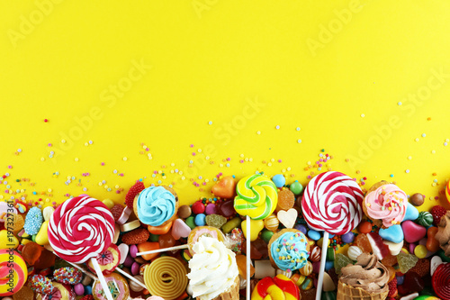 Confiserie candies with jelly and sugar. colorful array of different childs sweets and treats.