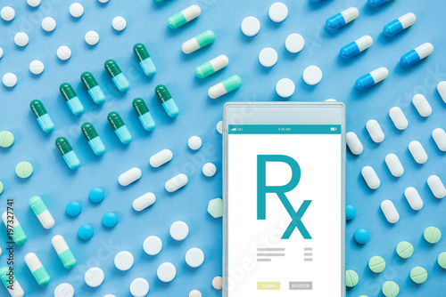 Photo  Various kinds of medical pills with Rx sign on smartphone screen