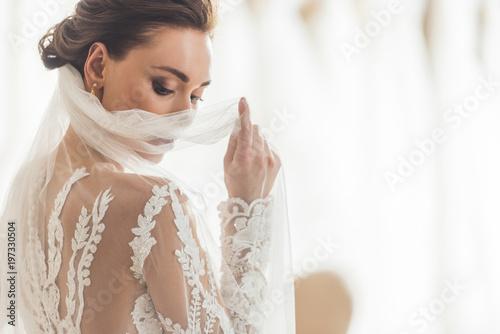 Obraz na płótnie Stylish bride in lace dress in wedding salon