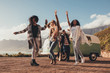 canvas print picture - Friends dancing outdoors on roadtrip