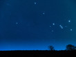 Dawn with stars and tree / countryside silhouettes.