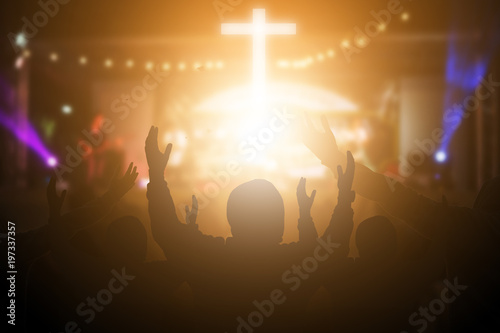 Christians raising their hands in praise and worship at a night music concert Canvas Print