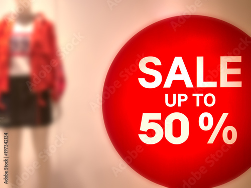 Photo Discount sign of 50 percent sale at store shopping window for promotion program