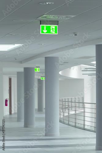 Staande foto Industrial geb. modern office corridor with emergency lights