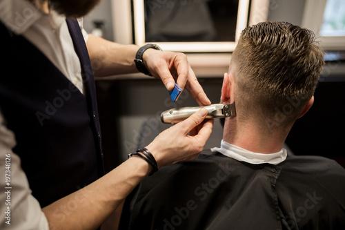 Man being trimmed at barber shop