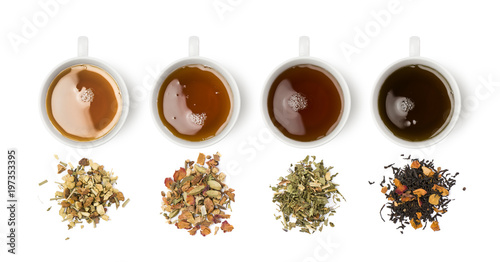 variety of tea blends with relative cups on white background