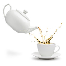 Teapot Pouring Tea Into Cup On...
