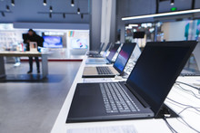 Laptops On The Table In The Electronics Store. The Department Of Laptops In The Tech Store. Buy A Laptop
