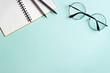 Leinwanddruck Bild - A notebook and glasses.