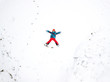 Winter aerial drone landscape with kid on snow