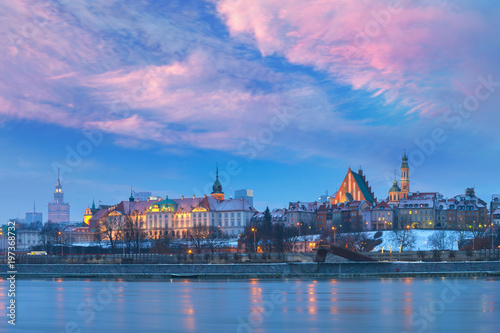 Fototapeta Panorama of the Old Town with reflection in the Vistula River at sunset, Warsaw, Poland. obraz