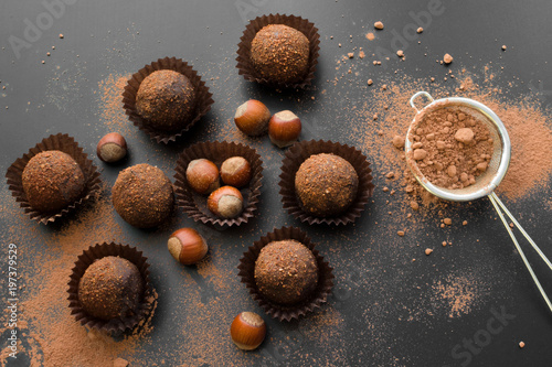 Fotografie, Obraz  small chocolate petit fours with hazelnuts top view